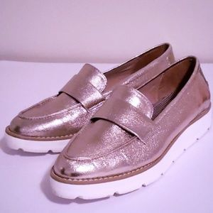 Rose gold loafers with white bottoms